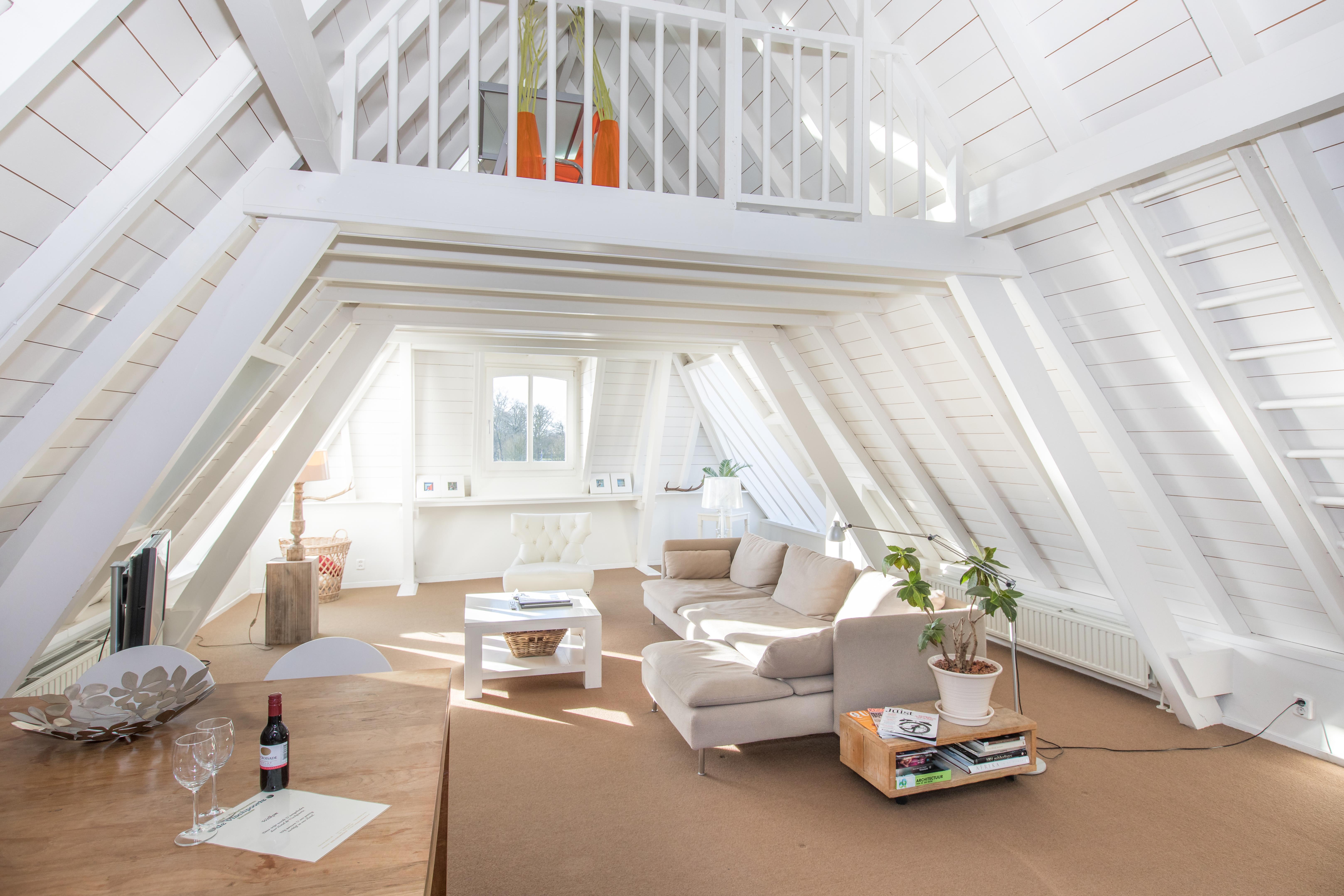 Luxe IJssel Penthouse, woonkamer
